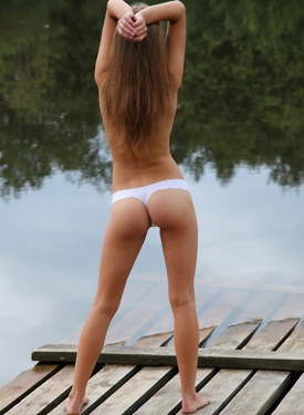 Teen in dress, white panties and nude by the lake