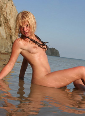 Blonde posing in the water