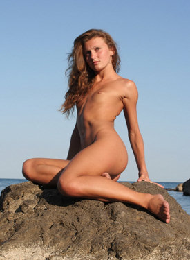 Teen nudist on the big stone