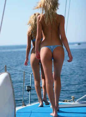 Bikini twins going nude at the boat