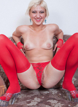 Sexy blonde wife has brought fruits dressed sexy in red top with jeans skirt and red stockings to strip and to show hairy pussy red see-through panties cameltoe