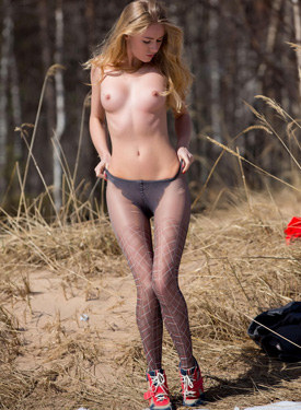 Topless teen in red skirt and pantyhose in the autumn forest
