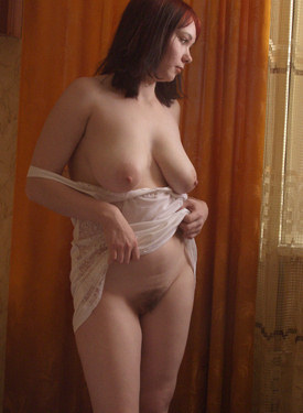 Hairy pussy babe with big boobs welcomes in her bed