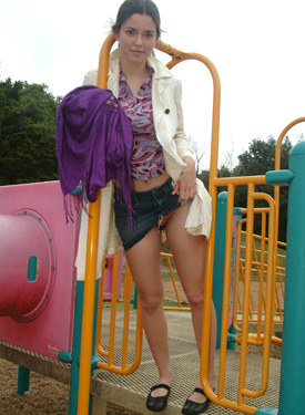Teen in jeans skirt at playground