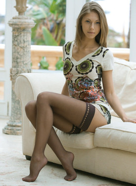 Exciting girl with nylon covered legs