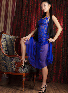 Exciting young asian in sexy blue see-through dress