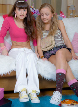 Lesbians - one in white jeans and sexy pink underwear, other dressed in skirt