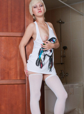 Blonde in long white t-shirt and white stockings showing her hairy beaver