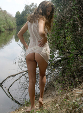 Wonderful young beauty is going nude outdoor