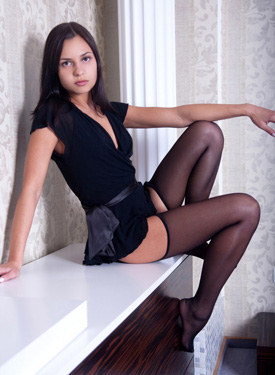 Hot brunette in sexy stockings