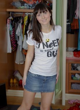 A girl in jeans skirt flashing white panties