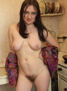 Big boobs chick with hairy pussy posing in the kitchen