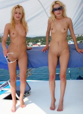 Bikini twins going nude at the boat