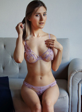 Exciting busty blonde beauty in see-through magenta sexy underwear