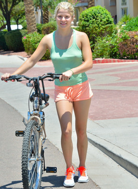 Fit extreme tight clothed girl cycling outside flashing tits