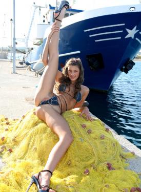Glamour sexy girl in bikini is fishing nude