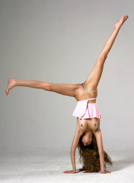 Gymnast in pink skirt