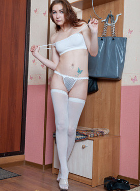 Sexy young beauty in white stockings and sexy blue skirt has hairy slut in see-through white string panties and puffy nipples under white top