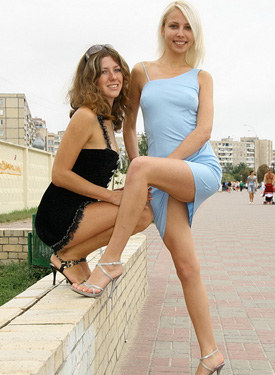 Two exciting fashion girls flashing panties outdoor