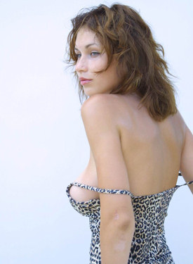 Young and busty in leopard dress