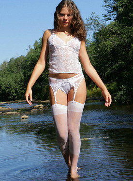 Young girl in sexy white nylon at the lake showing white panties cameltoe